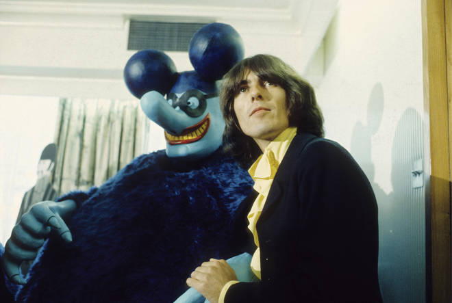 George Harrison with a Blue Meanie at the press screening of the film 'Yellow Submarine'