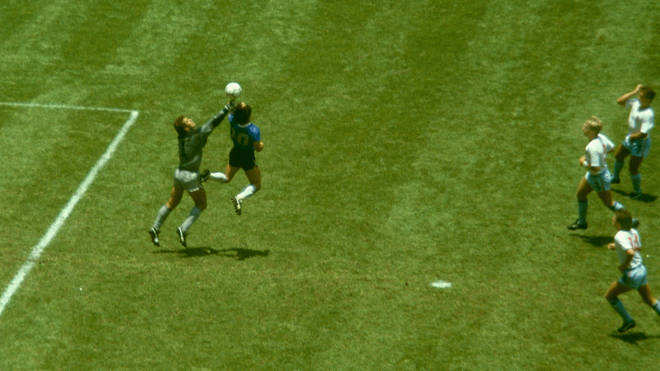 Diego Maradona outjumps England goalkeeper Peter Shilton to score with his 'Hand of God' goal at the 1986 World Cup