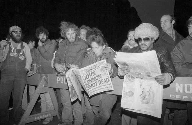 Crowds outside the Dakota react to the news of John Lennon's death on 9 December 1980