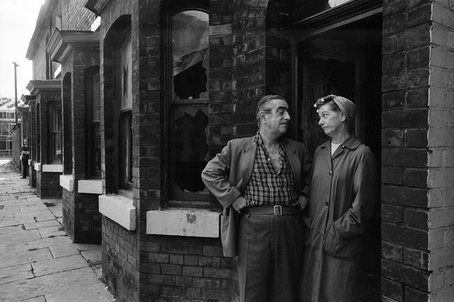 Bernard Youens and Jean Alexander aka Stan and Hild Ogden visit Archie Street shortly before it was demolished in August 1971. Archie Street was the basis for the fictional Coronation Street.
