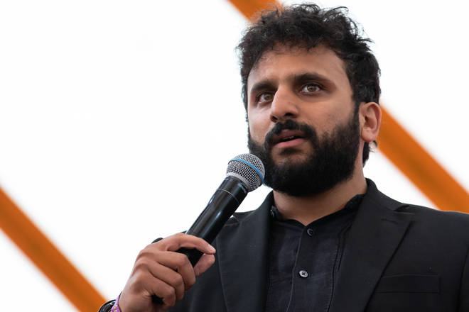Nish Kumar performs on the comedy stage during Latitude Festival 2019