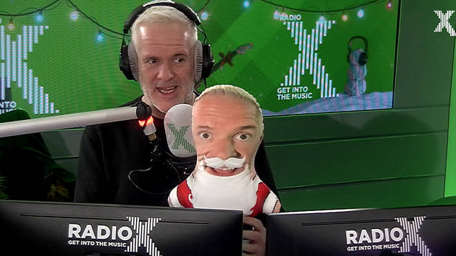 Chris Moyles holds a stuffed toy version of himself
