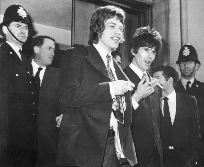 Mick Jagger and Keith Richards leave court after being charged with drug possession, 1967