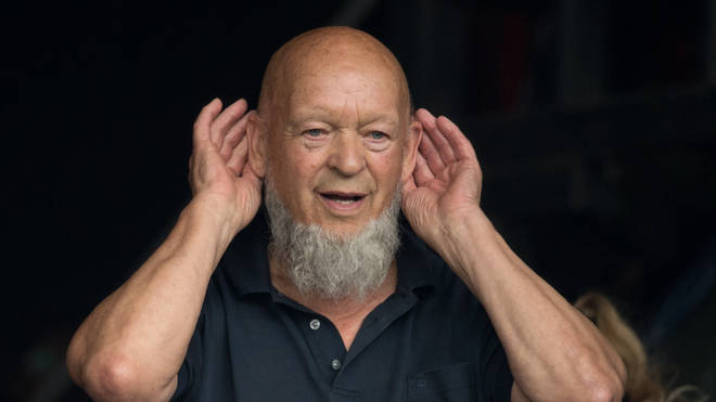 Michael Eavis holds his hands to his ears at Glastonbury 2017
