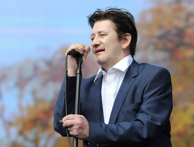 Shane MacGowan onstage with The Pogues in 2014