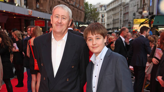 Archie Lyndhurst with his father Nicholas in August 2015