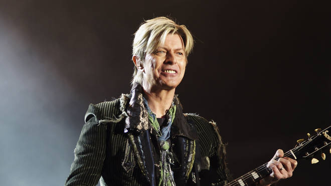 David Bowie performs his last full gig in the UK: closing the Isle Of Wight Fesival, 13 June 2004
