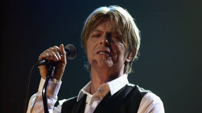 Bowie pefforms as part of curating Meltdown in June 2002