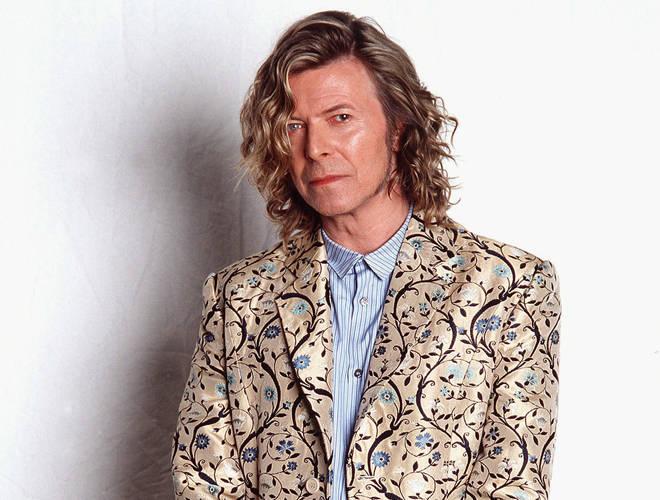 Bowie backstage at Glastonbury in his Alexander McQueen coat, June 2000
