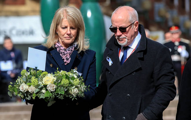 Wendy and Colin Parry lay flowers at the memorial stone on Bridge Street, in Warrington on the 25th anniversary of the bombing in 2018