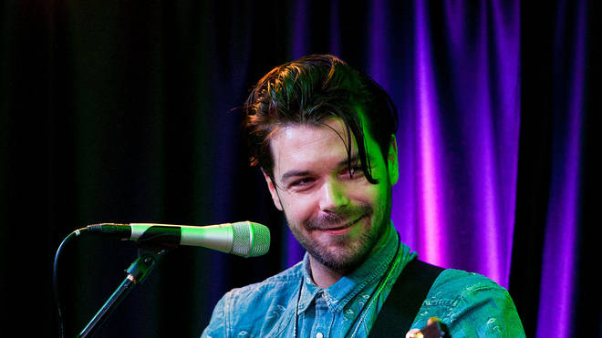 Aimon Simon Neil of Biffy Clyro performs at the 104.5 iHeart Performance Theater in 2013