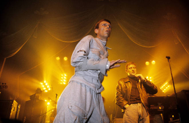Bez does his thing for Happy Mondays while bandmate Shaun Ryder looks on