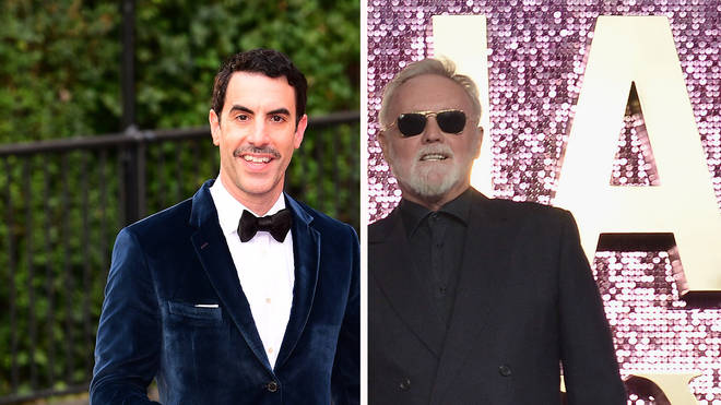 Actor Sacha Baron Cohen and Queen drummer Roger Taylor