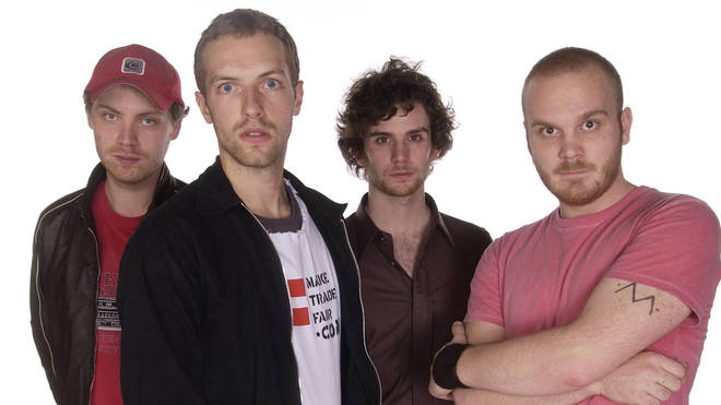 Coldplay in November 2002: Jonny Buckland, Chris Martin, Guy Berryman, and Will Champion