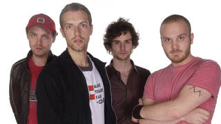 Coldplay in November 2002: Jonny Buckland, Chris Martin, Guy Berryman, and Will Champion