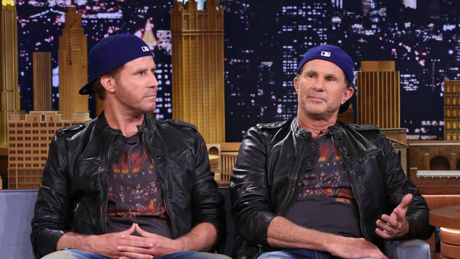 Actor Will Ferrell sits next to Red Hot Chili Peppers drummer Chad Smith in 2014