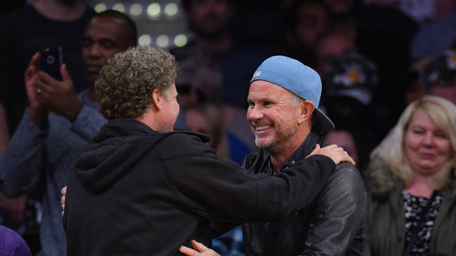 Will Ferrell and Chad Smith attend a basketball game between the Detroit Pistons and the Los Angeles Lakers at Staples Center on November 15, 2015