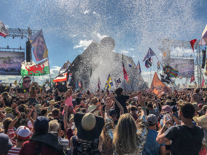 Somewhere in there, behind the confetti and the flags is Kylie Minogue, performing the Glastonbury legends slot in 2019