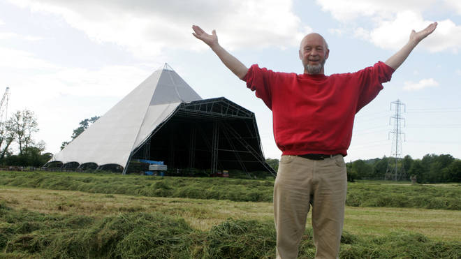 Michael Eavis and the iconic Pyramid Stage at the Glastonbury Festival site in 2005