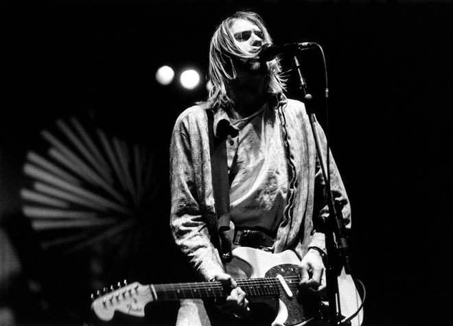 Kurt Cobain performing live onstage with Nirvana at Palasport, Modena on 21 February 1994