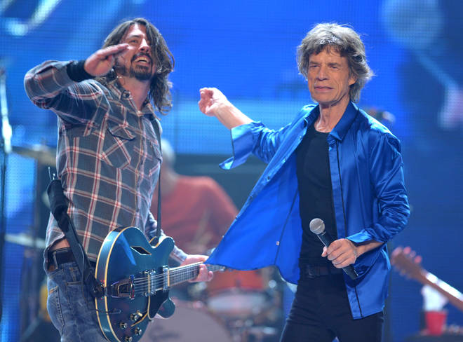 Dave Grohl joins Mick Jagger and the rest of the Stones onstage in 2013
