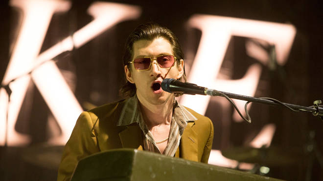 Alex Turner performing with Arctic Monkeys in Denver, June 2018