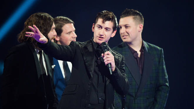 Alex Turner and his fellow Monkeys at the BRIT Awards, 19 February 2014