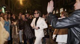 Ewan McGregor as Halston, entering Studio 54