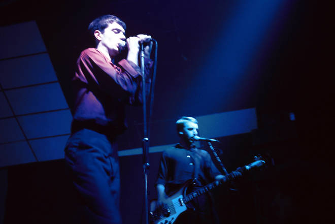Ian Curtis and Peter Hook performing live at London's Electric Ballroom on 26 October 1979. The day before they'd played Bradford. The following day, they'd be back in Manchester for another show.