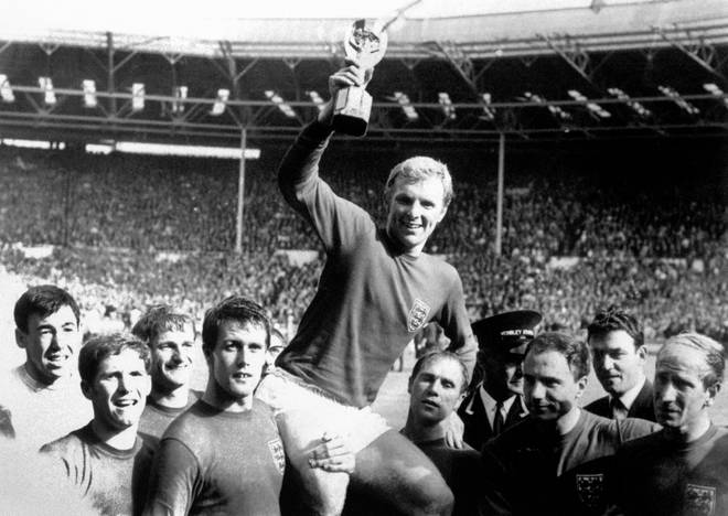 Bobby Moore holds aloft the Jules Rimet trophy as England win the World Cup in 1966