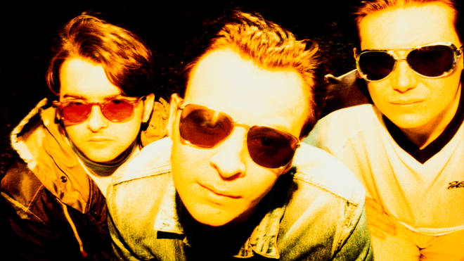Sean Moore, James Dean Bradfield and Nicky Wire backstage at Parkpop Festival in The Hague, Netherlands on 21 August 1994. Richey Edwards was then in hospital with nervous exhaustion, prompting rumours that he was about to leave the band.