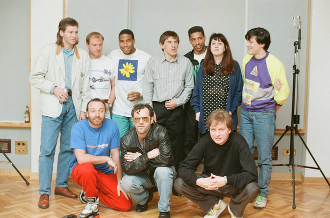 Some of New Order (and Tony Wilson and Keith Allen) recording World In Motion with some of the 1990 England squad: Steve McMahon, Chris Waddle, Peter Beardsley, John Barnes and Des Walker
