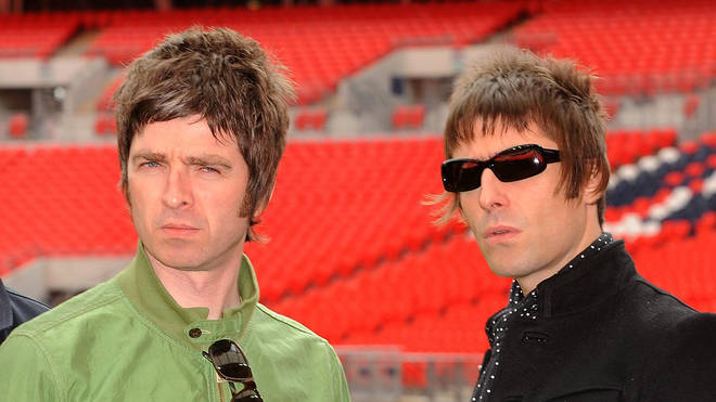 Noel and Liam Gallagher pose at Wembley Stadium on October 16, 2008