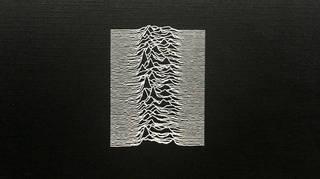 A close-up of Joy Division's Unknown Pleasures album cover
