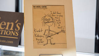 The signed self portrait drawing by Nirvana's Kurt Cobain went for $281,250