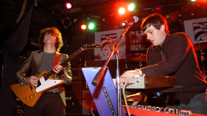 Dave Keuning and Brandon Flowers performing with The Killers at the CMJ Music Marathon October 2003