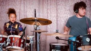Nandi Bushell and Matt Helders drum to Arctic Monkeys Brianstorm