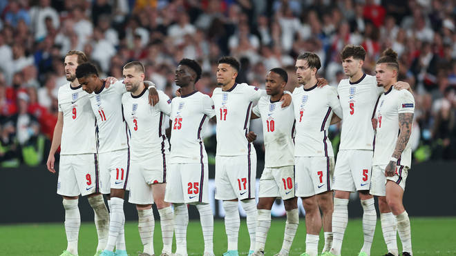 The England players look on from the half way line as Harry Maguire steps up to take England's second penalty.