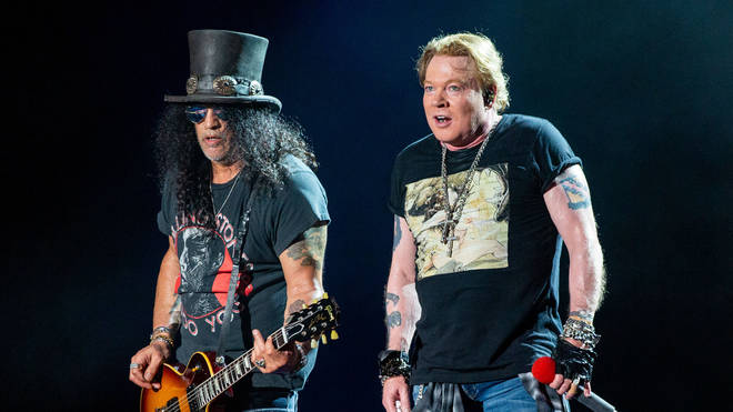 Axl Rose and Slash performing with Guns N'Roses in Texas in October 2019