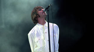 Liam Gallagher on stage with Oasis at Knebworth, 10 August 1996