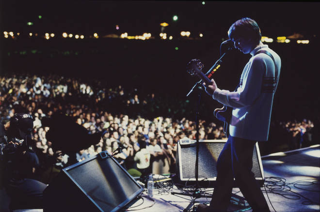 Noel Gallagher on stage at Knebworth, August 1996