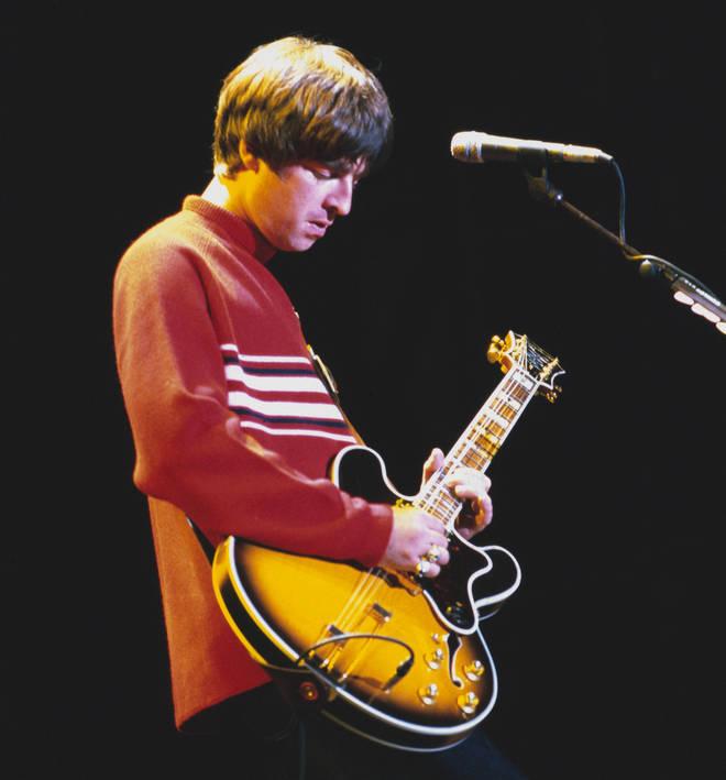 Noel Gallagher performing live at Knebworth, August 1996