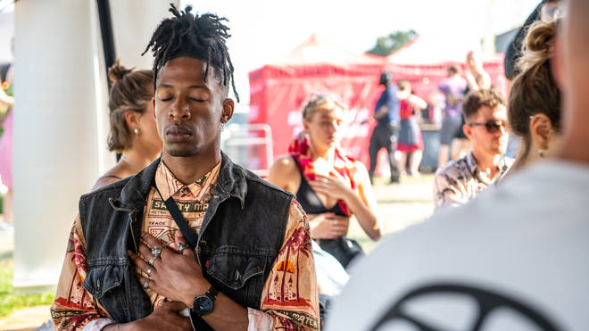 Festival-goers practice meditation at Cross The Tracks 2021