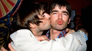Liam Gallagher giving brother Noel a kiss.