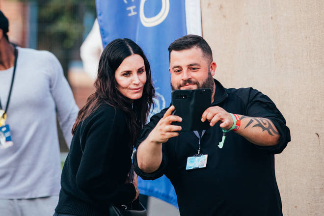 Courtney Cox got into the festival spirit, heading to the Isle Of Wight to see boyfriend Johnny McDaid of Snow Patrol.