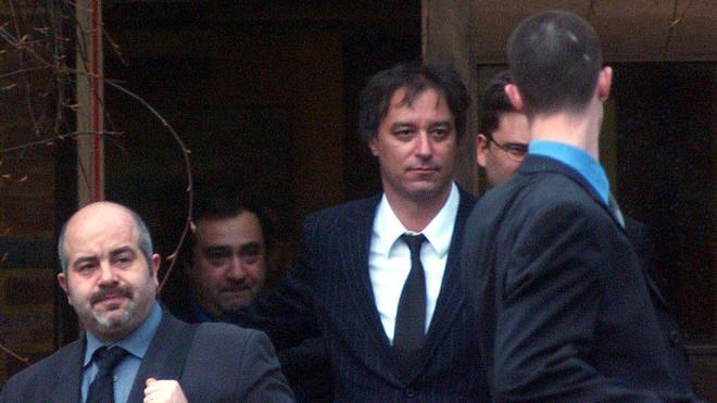 Peter Buck arrives at court, 2002