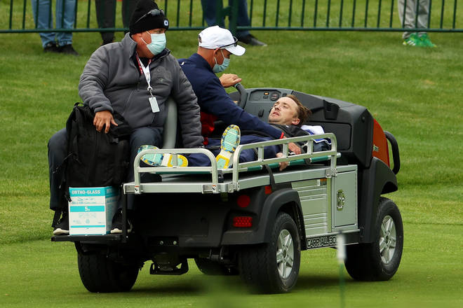 Tom Felton is carted off the course after collapsing during the celebrity matches ahead of the 43rd Ryder Cup