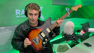 Sam Fender with the signed Fender Jazzmaster guitar that you could win and help raise money for Global's Make Some Noise