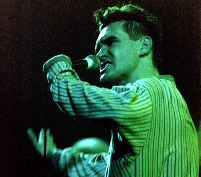 Morrissey of The Smiths performs on stage at Brixton Academy in 1986