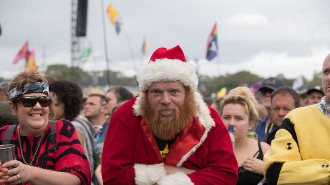 A man dressed as Father Christmas waits for Royal Blood to perform on the Pyramid Stage at Glastonbury Festival 2017